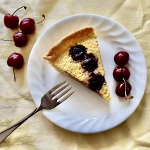 A delicious slice of cherry custard pie