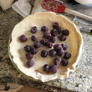 Frozen black cherries in pie crust