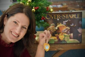 Author Suzanne Nelson holds up the ornament