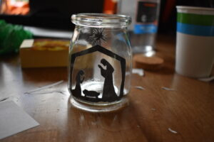 Glue the silhouette to the inside of your jar