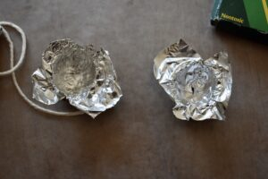 Line your walnut shell with a small piece of tin foil